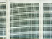 Safety Protection Of  Windows In Sporting Hall. Window Covered  With Woven Safety Net. Reflection In poster