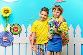 Happy joyful children in a summer garden. Childrens fashion. Happiness, activity and child concept. poster