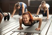 Young Fit Sporty Woman With Painful Face Expression Doing Hard Difficult Plank Fitness Exercise Or P poster