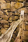 stock photo of split rail fence  - A wooden split rail fence ends at a stone rock wall - JPG