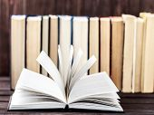 Old Books On Wooden Background. The Source Of Information. Books Indoor. Home Library. Knowledge Is  poster