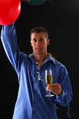 pic of bachelor party  - A happy handsome man at a party with a balloon and champagne - JPG