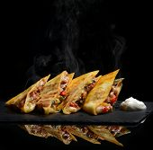 Mexican Quesadilla Wrap With Chicken   Sweet Pepper Sour Cream And Salsa Hot With Steam Smoke On Bla poster