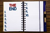 Writing Text Showing The End. Business Concept For End Finish Close Written On Notebook Paper, Woode poster