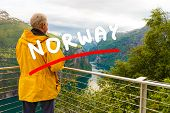 Tourism Vacation And Travel. Male Tourist Enjoying Beautiful View Over Magical Geirangerfjorden From poster