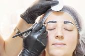 Eyebrow Dyeing. Beauty Saloon. The Girl Lies With Her Eyes Closed On The Eyebrow Dyeing Procedure. T poster