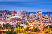Tacoma, Washington, USA skyline and highways at night. poster