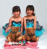 stock photo of tea party  - cute little girl ballerinas in costumes having tea party - JPG