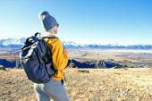 Hiker Hiking On Mountain Peak. Female Hiker, Sport And Trekking In Autumn Nature. poster