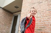 Boy bully laughing and pointing outside of a school, shallow focus on boys fingers poster