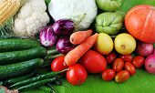 foto of brinjal  - Fresh colorful vegetables from organic farm showing various vegtables including cucumber tomato brinjal carrot etc - JPG