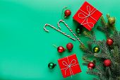 Christmas Gifts In Red Boxes, Green And Red Christmas Balls, Candy-canes And Christmas Tree Branch O poster