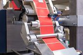 Fragment Of The Conveyor Of The Pharmaceutical Labeling Machine. Abstract Industrial Background. poster