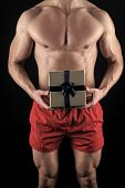 Sexy Surprise Concept. Macho Muscular Torso Posing With Gift Box. Santa Claus For Adult Girls. Sexy  poster