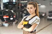Charming, Beautiful Girl Holding Wrenches, Looking At Camera, Posing. Pretty Young Woman Working As  poster