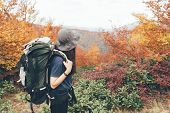 Girl On An Expedition Trip With A Heavy Backpack And Bucket Hat In A Forest In The Mountains On An A poster