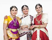 stock photo of bharatanatyam  - three pretty female dancers   of indian origin having a discussion - JPG