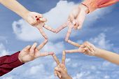 picture of v-day  - Victory gesture star shape made from human hands - JPG