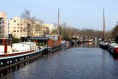 stock photo of houseboats  - Houseboats in a canal in the  city of Groningen - JPG
