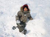 stock photo of ruddy-faced  - Little boy plays winter day - JPG