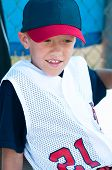 stock photo of little-league  - Little league baseball player watching from the dugout - JPG