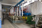 picture of dynamo  - Industrial size generators in a factory machinery room - JPG