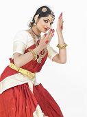 stock photo of bharatanatyam  - pretty female Bharathanatyam dancer of Tamil nadu in South India - JPG