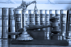 stock photo of jury  - Symbol of law and justice with books law and justice concept focus on the gavel blue tone - JPG