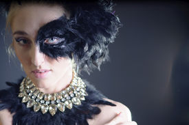 image of azazel  - portrait of sexy woman with black feather half mask for Venice desire concept - JPG