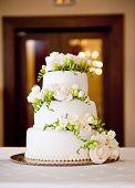 stock photo of icing  - Beautiful and tasty wedding cake at wedding reception - JPG