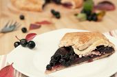 foto of aronia  - Close up of aronia and apple pie on plate selective focus retro style - JPG
