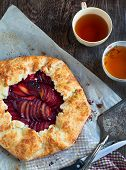 Fresh Homemade Plum Galette On Wooden Table