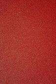 Extreme Abstract Closeup Of Red Sheet Of Sandpaper
