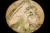 stock photo of cherubim  - Grieving Angel on the old graveyard granite stone - JPG