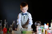 image of physicist  - Image of young physicist experimenting with the reagents - JPG