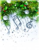 Image of Christmas treble clef on notes pages, beautiful melody, silver ornament on green fir tree b