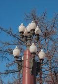 stock photo of lamp shade  - Street lantern with many white lamp shades - JPG