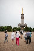 LUSHUN, CHINA - JUNE 10, 2012: Tourists at monument to Soviet soldiers, russian name Port Arthur, is