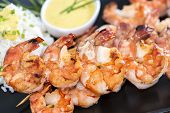 image of tiger prawn  - Skewered Tiger Prawns with a portion of fresh Rice