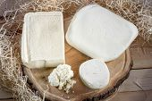 pic of meals wheels  - cottage cheese on wooden desk with hay on background - JPG