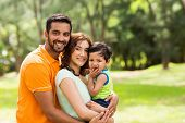 picture of indian  - beautiful young indian family outdoors looking at the camera - JPG