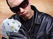 picture of thug  - Chief boss mafia gangster thug with stolen money euro - JPG