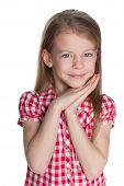 picture of shy girl  - A portrait of a shy little girl against the white background - JPG