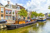 foto of pontoon boat  - old boats in a canal in Harlingen - JPG