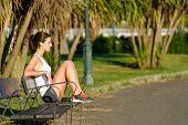 foto of work bench  - Relaxed woman taking a rest after running and fitness exercising outdoor in park - JPG