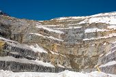 foto of open-pit mine  - Open Pit Copper Mine in Chile covered by snow - JPG