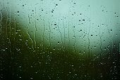 image of raindrops  - Closeup of water drops droplets raindrops on glass window as background texture - JPG