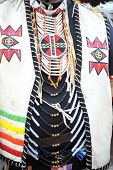image of ceremonial clothing  - Native American Indian dressed for ceremony dance performance outside - JPG
