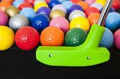 picture of miniature golf  - Colorful mini golf balls with a green club - JPG
