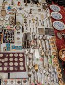 image of crockery  - Selling vintage cutlery crockery military insignia coins and medals at the flea market - JPG